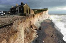 Photo of a building perilously perched on the edge of a crumbling cliff