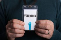 Man holding volunteer card