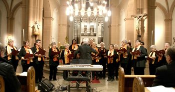 A choir in a sanctuary getting ready to sing