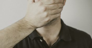 Male covering his mouth with his hand. 9 Things Preachers Should Never Say