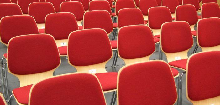 A bunch of red chairs set up in an overflow room on Easter Sunday