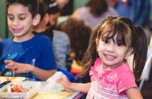 Photo of happy children coloring