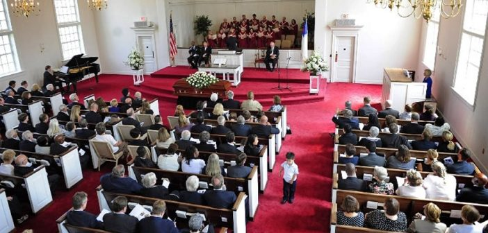 Photo of a church funeral. CREDIT: Pool / Roll Call Photos Inc. / Newscom / Universal Images Group. Rights Managed