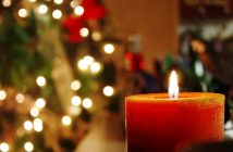Photo of a Christmas tree and burning candle