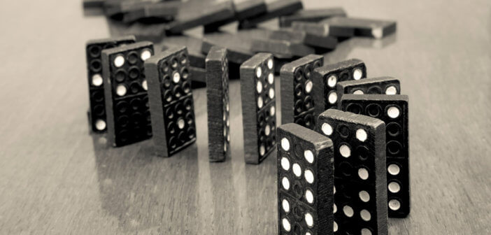 Dominoes precipitously lined up and ready to fall