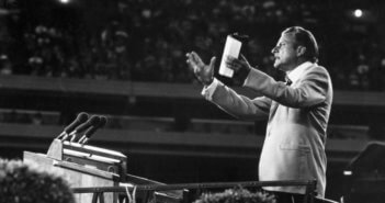 Billy Graham addresses a large crowd. CREDIT: Keystone / Getty Images / Universal Images Group, Rights Managed / For Education Use Only
