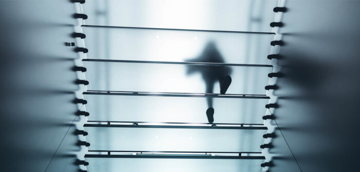 Person walking up a translucent staircase