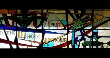 Stained glass window with the text Put on the Whole Armour of God