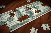 Jigsaw puzzle in the shape of a $100 bill