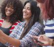 Diverse group of millennials taking a selfie