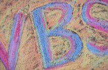 VBS drawn in sidewalk chalk