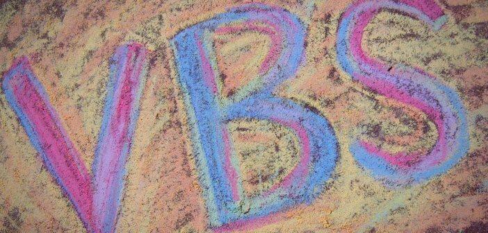 VBS drawn in sidewalk chalk