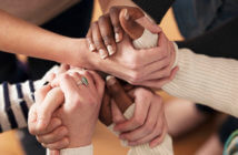Close up of a group of people's hands clasped together