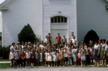 Vintage group photo of a congregation out front of the old Dawson Baptist Church in Philpot, Ky.
