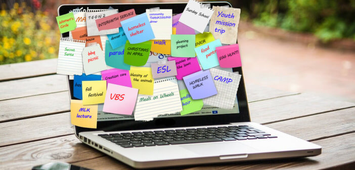 Laptop screen covered with sticky notes