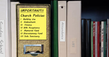 Bookshelf with binder of church policies