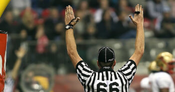 Football referee with arms raised for a touchdown