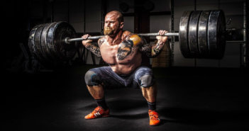 Weightlifter struggling to lift heavy weights