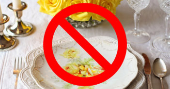 Fancy place setting of fine china with a DO NOT symbol superimposed