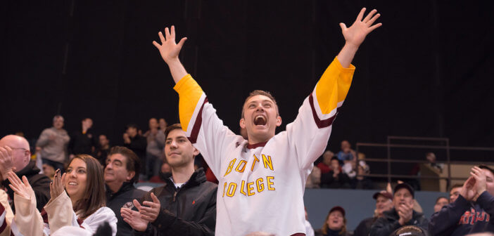 Very excited fan cheering at a hockey game