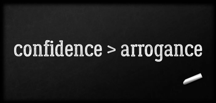 confidence > arrogance written in chalk