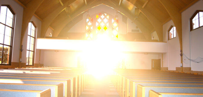 Interior of a church with beautiful, hopeful sunshine streaming in