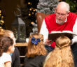 Reading to young children at Christmas Eve service