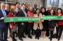 Members of Arlington Presbyterian Church help cut the ribbon on Gilliam Place -- affordable housing that was created in the redevelopment of the church building and property