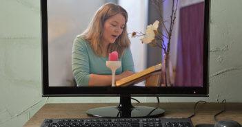 Desktop computer displaying online worship