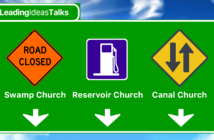 Highway sign showing directions to Swamp Church, Reservoir Church, and Canal Church