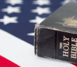 Time-worn Bible resting upon an American flag