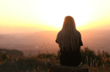 Person taking in a beautiful sunrise