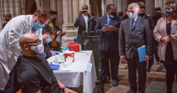 Dr. Fauci watches as a clergy member receives their vaccination at an event at Washington National Cathedral - https://cathedral.org/
