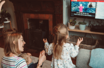 Family clapping and interacting with online worship from their living room