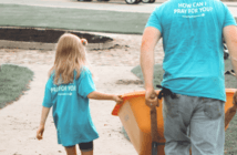 Child and adult volunteering together at a church service project