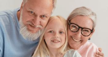 Smiling grandparents and grandchild
