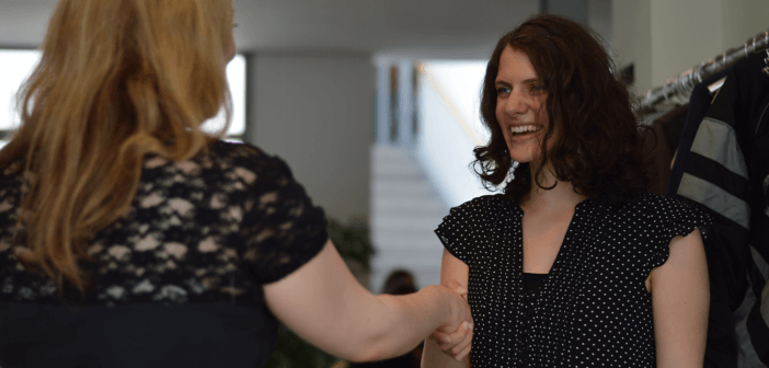 Person receiving a warm greeting at church