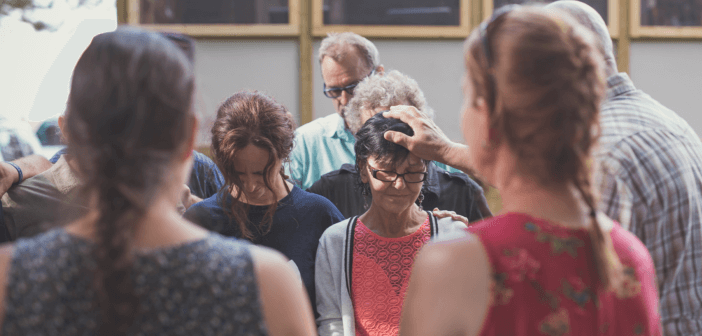 People being commissioned at church