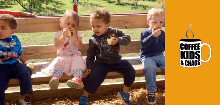 Kids outside on a bench having snacks